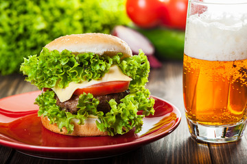 Cheeseburger on a plate with beer