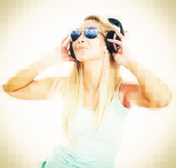 Young female DJ listening music in headphones.