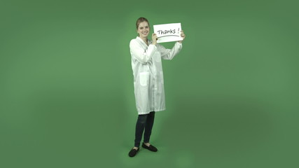 attractive caucasian girl with lab coat isolated on green