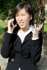 Angry asian woman on the phone