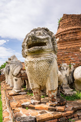 Stone mythical creatures at ancient temple, Thailand.
