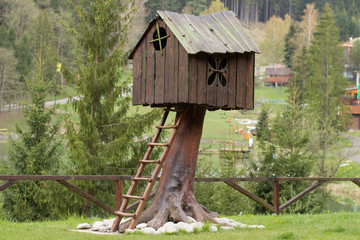 Interesting wooden tree house for children