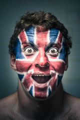 Shocked man with British flag painted on face