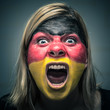 Angry woman with flag of Germany painted on face