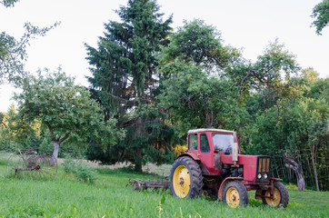 rustic farm tractor in summer garden
