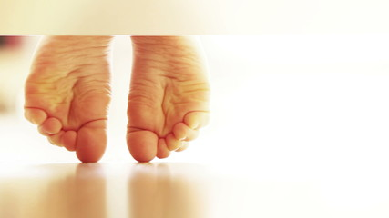 Gently child's feet on the laminate flooring : UNDERbed view