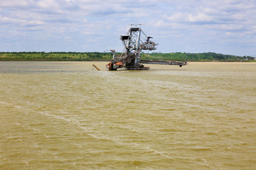 Consequences of catastrophic flood in the open pit mine