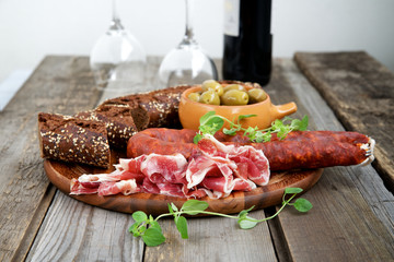 Spanish tapas - jamon, chorizo ​​and olives