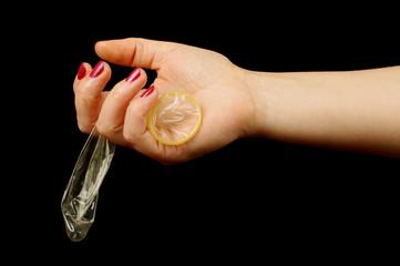 Woman hand holding condom