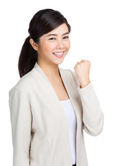 Young woman with fist up