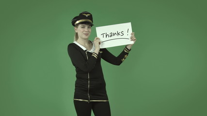 attractive caucasian air hostess isolated on green grateful with