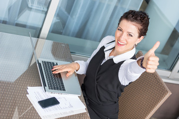 Successful Young Businesswoman with Computer