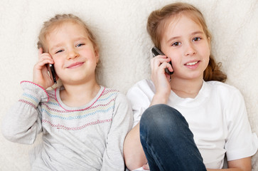 Children talking on mobile phone