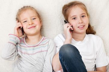 Children talking on mobile phone