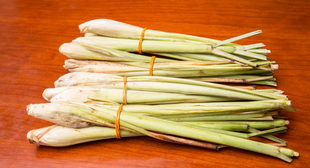 A bunch of lemongrass on wooden surface