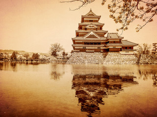 Matsumoto castle in old paper background, Japan