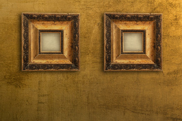two vintage gold picture frames on the wall gold