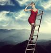elegant woman on a ladder
