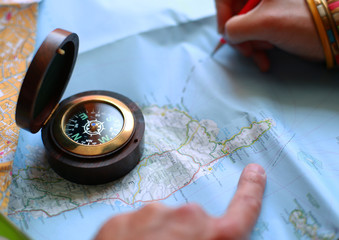 Route on the map with the help of a compass, travel