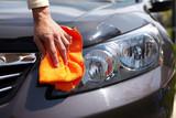 Fototapety Hand polishing car.