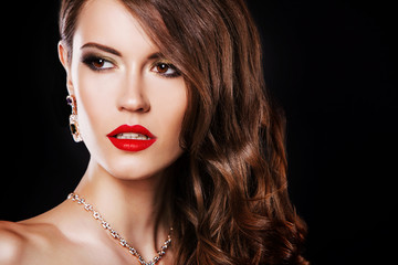 close up portrait of beautiful brunette woman with luxury