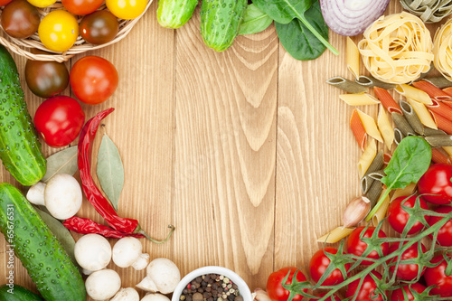 Fresh ingredients for cooking: pasta, tomato, cucumber, mushroom