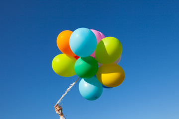 flying huge balloons blue sky