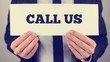 Holding Call us sign