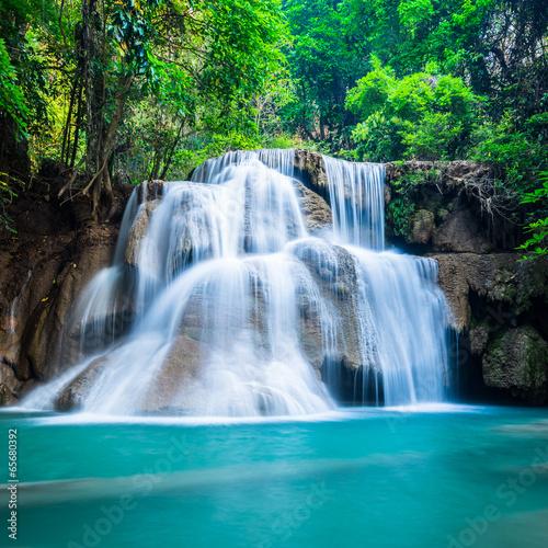 Deep forest waterfall at National Park Kanchanaburi Thailand - 65680392