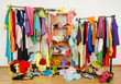 Untidy cluttered woman wardrobe with clothes and accessories. - 65680526
