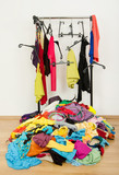 Untidy cluttered woman wardrobe with clothes on the floor. poster