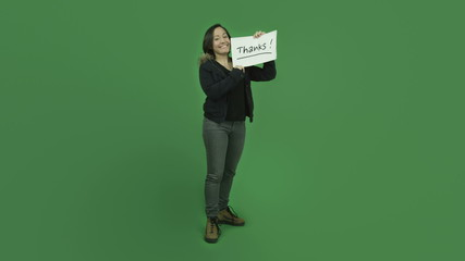 caucasian girl with winter jacket isolated on green screen