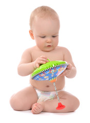 Infant child baby boy toddler playing with whirligig toy