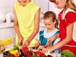 Children cooking at kitchen.