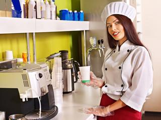 Woman with coffee machine.