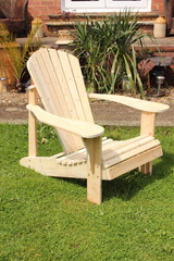 A handmade Adirondack style chair made out of old recycled wood