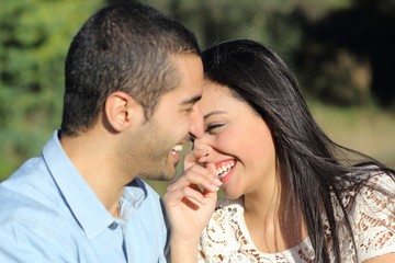 Arab casual couple man and woman flirting and laughing happy