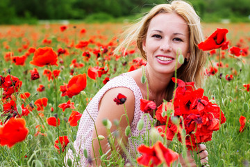 Summer girl in poppy field