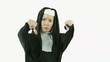 caucasian nun isolated on white expressing negativity thumbs