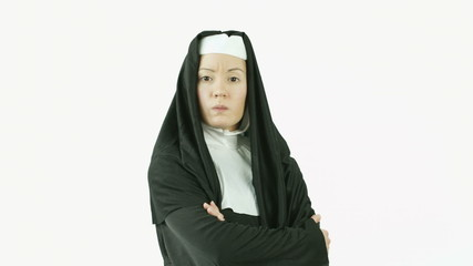 caucasian nun isolated on white upset anger arms crossed