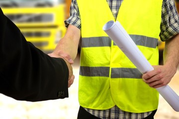 Construction worker's hand shaking hands.