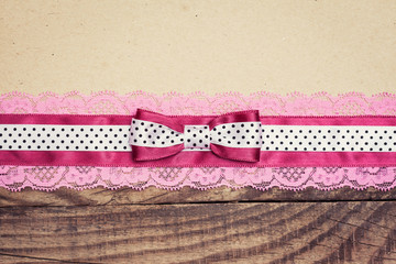 vintage background with wood, old paper and pink and white polka