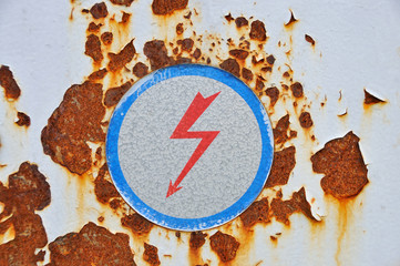 High voltage sign on rusty metal