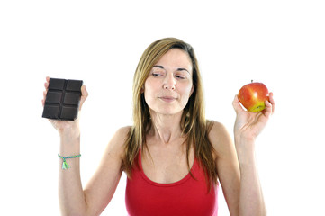 slim 40s Woman with Apple and Chocolate in Hands to choose