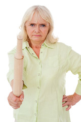 Senior woman with rolling pin.