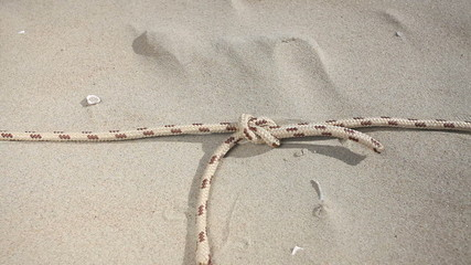 Line rope on the beach. HD with motorized slider.