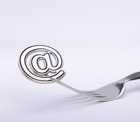 email symbol on a fork isolated on white background