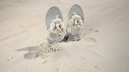 Female flip-flops on the beach. Full HD with motorized slider.