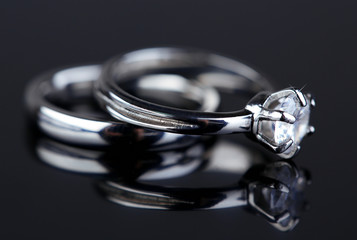 Two beautiful rings on gray background