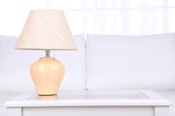 Lamp on coffee table in room